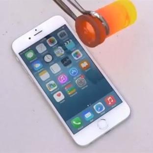 iPhone 6'nın üzerine erimiş alüminyum döktüler