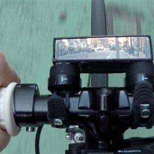 <span>Bisiklette Geriye</span><br /><span>Bakmanın Yeni Yolu</span><br /><span>Pedi-Scope</span><br />
