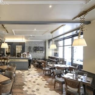 Yellow Office Architecture'dan El Greco Restaurant