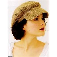 Kasketine kurdele geçirilmiş bayan şapkası