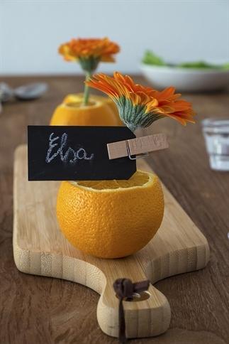 Tafeldecoratie met Gerbera's en sinaasappels.