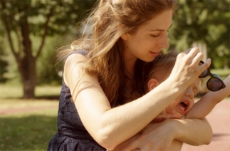 Je kind insmeren met zonnebrand is jouw taak!